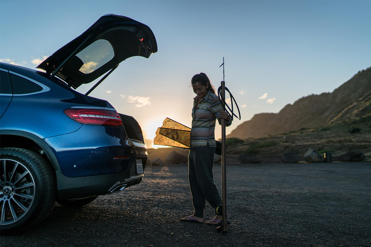 Kimi Werner taking out her spearfishing gear out of a Mercedes-Benz
